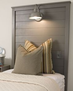 Headboard with built-in light - love this idea - i could read in bed easier AND clean up space on the nightstand!