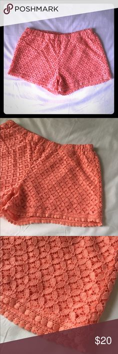 Coral Lace Shorts Purchased at Aeropostale and worn a few times over the summer. They're really cute I just don't have a lot to pair them with which is why I didn't wear them often. The pictures make them look a little bit more on the orange side but they are a little more pink in person. I just couldn't get good pictures of the color. 78% cotton, 22% nylon, dry clean. Open to negotiate with reasonable offers. **I DO NOT SWAP SO PLEASE DON'T ASK** Aeropostale Shorts