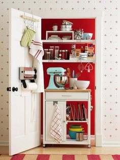 I LOVE THIS! Closet to Mini Kitchen - This handy closet eases prep and cleanup time by curbing kitchen clutter. A rolling cart pairs small appliances with utensils for an efficient workstation. Over-the-door hooks provide an accessible spot for dishrags and oven mitts, and a mounted towel dispenser makes for easy cleanup.