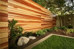Horizontal fence with wood color variation.