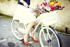 red shoes and a basket full of flowers.