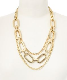 This Gold Triple Chain Bib Necklace by NES Jewelry is perfect! #zulilyfinds
