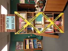 Book bully shelf display to remind kids to take care of library books. It has been very effective at getting kids to take responsibility for their books!