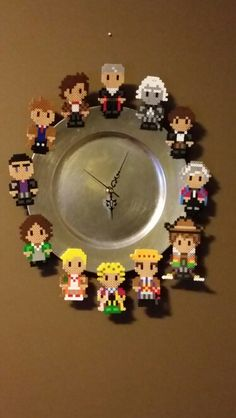 DIY Doctor Who Perler Bead Clock. Also, the seventh doctor is supposed to be in place of the fifth. Probably done by mistake. Melty Bead Patterns, Perler Patterns, Beading Patterns, Hama Beads, Fuse Beads, Doctor Who Craft, Diy Doctor, Nerd Crafts, Diy And Crafts