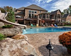 Outdoor living space, Pool cabana combined with fireplace for multi-seasonal use. Floor is stamped concrete that looks like planks. Dream Home Design, My Dream Home, House Design, Dream Life, Home Building Design, Amazing Buildings, Dream House Exterior, Dream Decor, Beautiful Homes