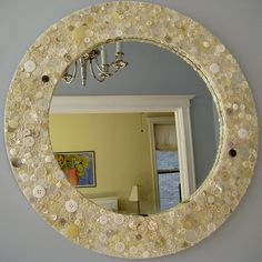 My next button project, button mirror!  I think a rectangle one for my girls' room would be amazing with pink and purple buttons. Great idea.