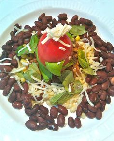 """Beans, corn, farro, topped with tomato & spinach with """"fake cheese."""" (No oil.)"""