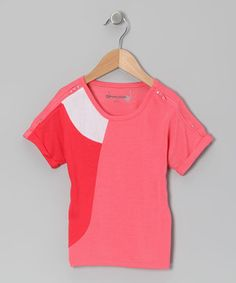 Curvy color blocking complements the structured shape of this top. Workable zippers at the shoulders add to the fun and function of this fashion.