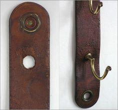 Vintage brass coathooks or wall hooks on leather strip, c.1900