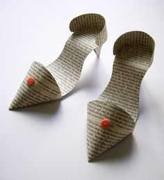 Example of bespoke hand-made paper shoes using pages from sue roe's novel 'estella; her expectations'