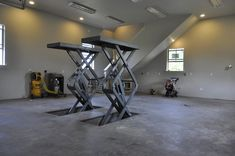 Love the idea of having a hydraulic garage lift that folds flat into the ground