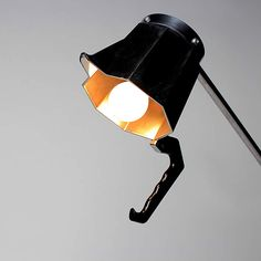 Beau Birkett upcycled an old espresso maker together with a vegetable rack into a stunning stylish desk lamp.