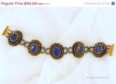 ON SALE Dazzling Blue Lapis Crystal & Gold Bead Embroidered Bracelet by AwenJewelry on Etsy, $76.00 - 8-1/4 inch bead-embroidered bracelet featuring five roundels of lapis lazuli, each surrounded by woven glass beads and joined with strands of Swarovski crystal and backed with velvety suede leather. Gold-plated 3-strand slide lock clasp.