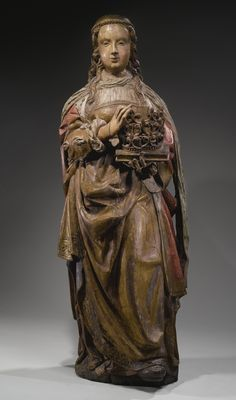 A PAINTED OAK FIGURE OF SAINT CATHERINE OF ALEXANDRIA, FIRST HALF 16TH CENTURY, PROBABLY NETHERLANDS