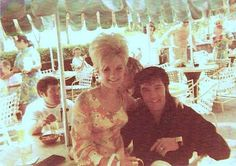Elvis Presley (with Charlie Hodge in the background) on holiday at the Ilikai Hotel in Honolulu, Hawaii  - 1969