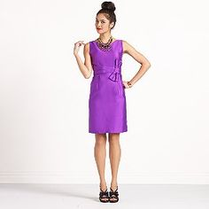 Love this purple sheath dress with the embelleshment at the waist!