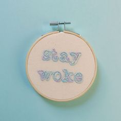 This cute little embroidery is for all the woke baes out there, stitched in variegated blue-lilac floss (its basically unicorn hair) on undyed calico.  Framed in a 4 natural wood hoop and backed with card.  If you like this embroidery, here are some others I think you ll dig: Resist: https://www.etsy.com/uk/listing/511736935/resist-in-rainbow-colours-hand?ref=shop_home_active_20 Nasty woman: https://www.etsy.com/uk/listing/511731261&...