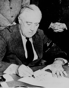 President Franklin D. Roosevelt signing the Declaration of War against Japan, December 8, 1941.