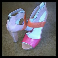 Great color block heal! Chunky heel with a zip up back! Nine West Shoes Heels
