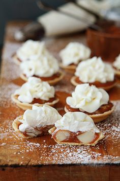 Caramel & Macademia Nut White Chocolate Tarts ~ This is a delectable little bite of caramel goodness mixed in with the nutty and salty crunch of macadamia nuts. To top off the tartlets is a mousse-like buttercream dollop of white chocolate frosting. Mmm...