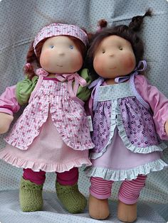 Ohmygoodness! Look at all the pretties! Waldorf doll clothing inspiration via Flickr