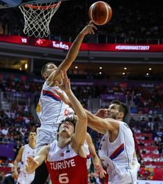 Stefan Jovic and Stefan Bircevic of Serbia in action against Cedi Osman of Turkey during the FIBA Eurobasket 2017 Group D Men's basketball match...
