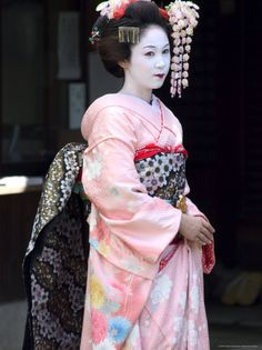 Geisha, Maiko (Trainee Geisha) in Gion, Kyoto City, Honshu, Japan  by Christian Kober