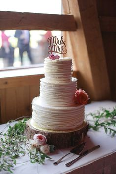 Mr and Mrs cake topper - photo by Laura Murray Photography http://ruffledblog.com/soft-and-romantic-colorado-mountain-wedding