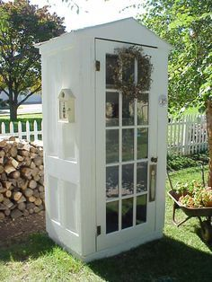 Tool shed made from old doors. You could make it more like a London phone booth by putting windows on the sides and painting it red.