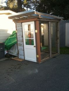 We put this greenhouse together in two days (minus paint). Recycled sliding glass doors, and reclaimed doug fir lumber. The siding on the front was redwood from our house when we replaced the siding...