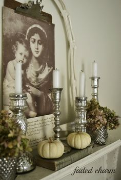 Mercury glass candle sticks on the mantle-could tie in my newest obsession of silver trays/platters!