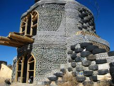Sustainable Living: Earthships - this Earthship is under construction and is also 2 storeys at least! Maison Earthship, Earthship Home, Earthship Biotecture, Natural Building, Green Building, Building A House, Bottle Wall, Bottle House, Natural Homes