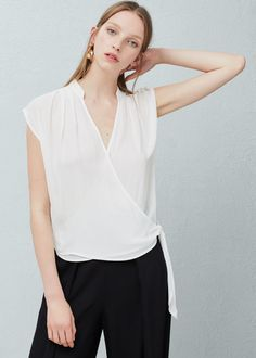 Wrap v-neckline blouse | MANGO