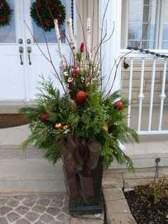 outside christmas planters - Yahoo Image Search Results Outdoor Christmas Planters, Christmas Urns, Christmas Front Doors, Outdoor Christmas Decorations, Winter Christmas, Christmas Holidays, Christmas Wreaths, Holiday Decor, Winter Porch