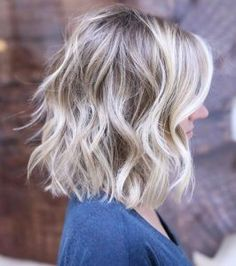 Short and textured blonde balayage by Brenda Kamt