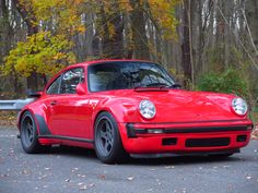 This 1986 Porsche 911 Turbo has 56k miles and is modified with many RUF parts. The modified 3.4 liter flat-six was rebuilt in 2014 at Dawe's Motorsports and is paired to a RUF dogleg 5-speed transmission. The suspension and brakes have been modified, and the wheels, body, and interior have also