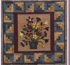 Wool applique wall hanging. Country Garden Bouquet Quilt Pattern FRD-1116 by Fairfield Road Designs - Christine Baker.  Check out our wall hanging patterns. https://www.pinterest.com/quiltwomancom/quilted-wall-hangings/  Subscribe to our mailing list for updates on new patterns and sales! https://visitor.constantcontact.com/manage/optin?v=001nInsvTYVCuDEFMt6NnF5AZm5OdNtzij2ua4k-qgFIzX6B22GyGeBWSrTG2Of_W0RDlB-QaVpNqTrhbz9y39jbLrD2dlEPkoHf_P3E6E5nBNVQNAEUs-xVA%3D%3D