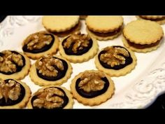 Delicious Moroccan butter cookies topped with chocolate and walnuts! Perfect gift for the Holidays!   Written recipe: http://cookingwithalia.com/index.php?option=com_zoo=item_id=235=110  Ingredients: 4 oz (113 grams) butter (softened) 1/2 cup and 2 tablespoons (125 grams) granulated white sugar 1 large egg A pinch of salt 1 teas...