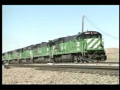 Wyoming Coal Trains - Burlington Northern and the Chicago & North Western benefit greatly by hauling this coal out of the Powder River Basin of Wyoming. Watch as each railroad uses its own main line, and then work together on the joint line moving the coal out of the state.    The Burlington Nort...