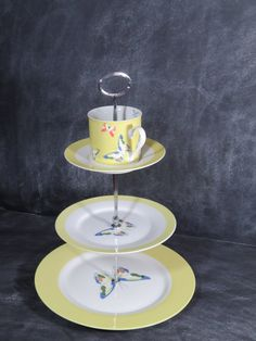 New to DancingDishAndDecor on Etsy: Teacup Tea Stand 3 Tier Cake Stand Butterfly Cake Plate High Tea Plate Stand Baby Shower Cake Stand Yellow Blue Green and White 122 (45.00 USD)