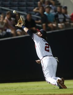 Atlanta Braves shortstop Dansby Swanson cannnot reach an RBI-single by  Washington Nationals  Bryce Harper in the fifth inning of a baseball game  in Atlanta 16a737c56d9