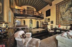 Inside Katy Perry's $6.5M home. Talk about luxe! The interior balconies, exposed beams, ornate staircases and enormous wall hanging give the home a distinct medieval feel.