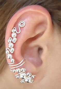 Our Ear Wraps, also known as Ear Cuffs or Ear Climbers, are worn on the ear without the need for any piercing and can be customized with our Dangle Attachments. Ear Jewelry, Body Jewelry, Jewelry Accessories, Jewelry Design, Jewelry Making, Unique Jewelry, Jewellery, Cuff Earrings, Wire Wrapped Jewelry