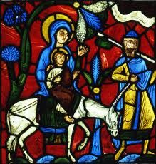 Stained glass painting of riding a donkey