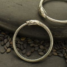 Hey, I found this really awesome Etsy listing at https://www.etsy.com/uk/listing/477625144/ouroboros-snake-sterling-silver-ring
