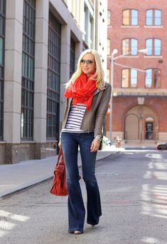 Red scarf with black and white striped shirt