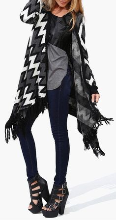 Super awesome look! Love the Aztec poncho and the heels and the skinny jeans, are a must.