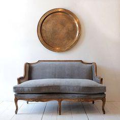 gray velvet, white wood floor, coppery brass