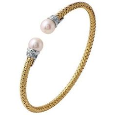 Perla, from our Charles Garnier Collection, is a sterling silver woven oval cuff bracelet with an 18k yellow gold finish and perl and CZ accents.