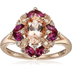 10K Pink Gold Floral-Shaped Diamond Morganite and Rhodolite Ring Add the feel of feminine glitz and classy to your hand with a rose gold with diamond morganite and rhodolite cocktail ring. The three tones from round-cut diamond oval-cut morganite and marquise-cut rhodolite configure flower shape make this cocktail ring unique and captivating. The floral design on its comfy 1.5 millimeters band that made of 10K rose gold or also known as pink gold will keep it on your finger day and night…